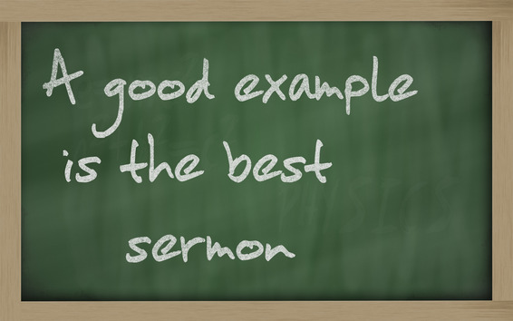 """ A good example is the best sermon "" written on a blackboard"